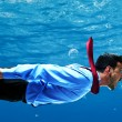 Stock Photo: Businessman swimming underwater