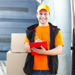 Smiling guy delivering a parcel — Stock Photo