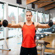 Man training in a fitness club — Stock Photo #34714887