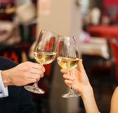 Couple toasting wineglasses — Stock Photo