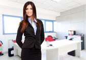 Business woman with hands behind her back — Stock Photo