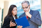 Business people reading a document — Stock Photo