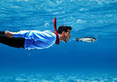 Funny businessman swimming underwater — Stock Photo