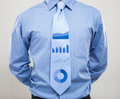 Business graphs on a necktie — Stock Photo