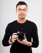 фотограф с фотоаппаратом рефлекс — Стоковое фото