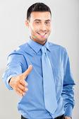 Businessman offering a handshake — Stock Photo