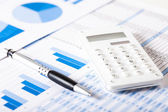 Calculator over financial documents — Stock Photo