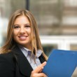 Businesswoman with clipboard — Stock Photo