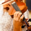 Violin being played by a musician — Stock Photo