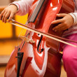Child playing cello — Stock Photo