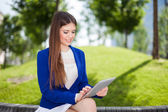 Woman using a tablet outdoor — Stock Photo