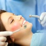 Dentist doing a dental treatment — Stock Photo