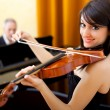 Stock Photo: Woman playing violin