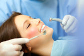 Dentist doing a dental treatment — Stock Photo
