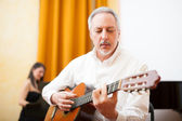 Guitarist playing an acoustic guitar — Stock Photo