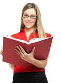 Jeune femme tenant un livre — Photo