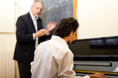 Man taking piano lessons — Stock Photo