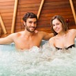 Couple relaxing in a whirlpool — Stock Photo