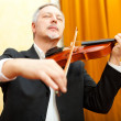 Musician playing his violin — Stock Photo