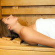 Woman relaxing in a sauna — Stock Photo #36074723