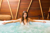 Woman relaxing in a whirlpool — Stock Photo