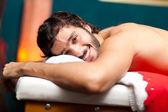 Man lying on a massage table — Stock Photo