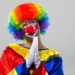 Stock Photo: Prayerful clown
