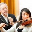 Violin teacher helping a student — Foto Stock