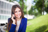 Attractive woman talking on phone — Stock Photo