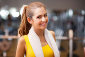 Woman smiling in a fitness club — Stock Photo