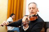 Senior violinist — Stock Photo