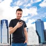 Man using his smart phone — Stock Photo