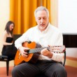 Man playing an acoustic guitar — Stock Photo