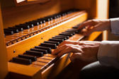 Man playing a church organ — Stock Photo