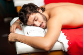 Sleeping Man having massage — Stock Photo