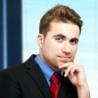 Businessman with hand on chin — Stock Photo