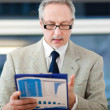 Stock Photo: Businessman with clipboard