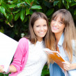 Two students in a park — Stock Photo