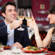 Stock Photo: Couple toasting glasses