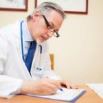 Doctor writing a prescription — Stock Photo