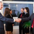 Stock Photo: Businesspeople shaking their hands