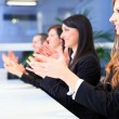 Foto Stock: Business people applauding