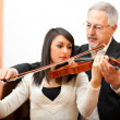 Violin teacher with a student — Stock Photo #38776537