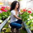 Woman in a greenhouse — Stock Photo #38776687