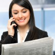 Business woman reading a newspaper — Stock Photo #38777033