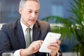 Man using his tablet — Stock Photo