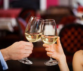 Couple toasting glasses — Stock Photo