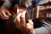 Guitarist playing a classical guitar — Stock Photo