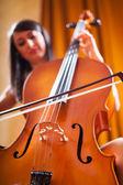 Beautiful woman playing cello — Stok fotoğraf