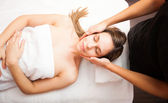 Woman having a facial massage — Stock Photo